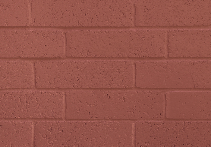 Close up of Bilco Gray Paintable Brick with dark red paint