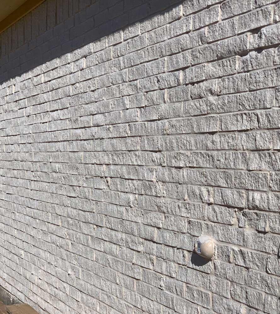 Bilco Stonehenge Split Face Brick Wall viewed at angle in sun