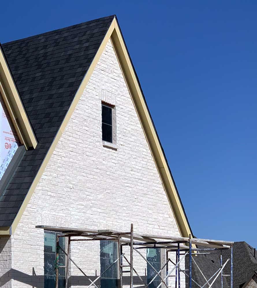 Bilco Stonehenge Split Face Brick gable in direct sun