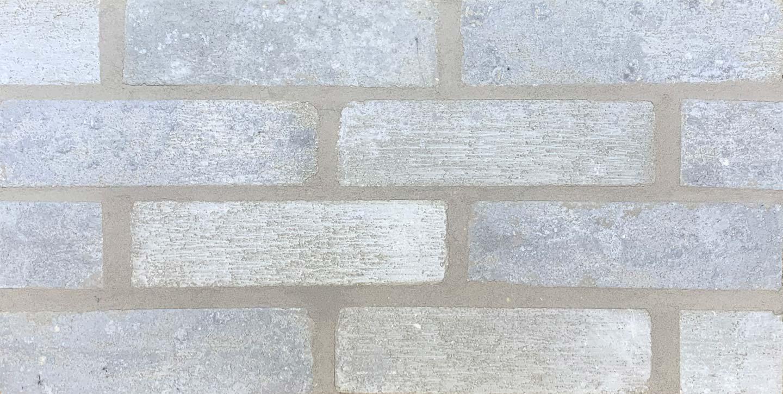 Bilco Brick Frost white brick with gray mortar